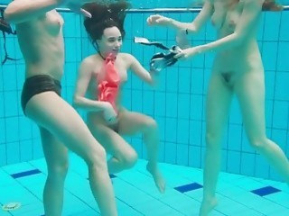 Three hot teen girls are in the pool naked