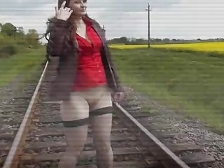 Russian MILF pees on the rails while wearing stockings