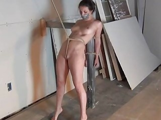 Big tits beauty is tied up in a naughty way