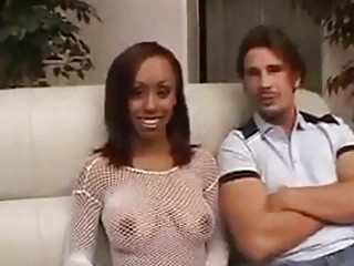 Luxurious ebony babe fucks on the couch in a cuckold
