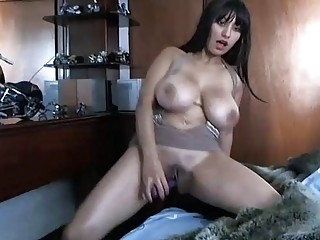 Big tits brunette using her favorite toy