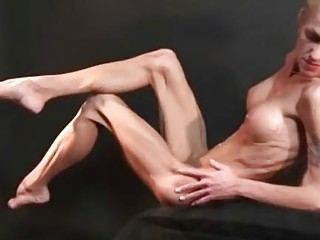 Very skinny mature shows her big tits and bones