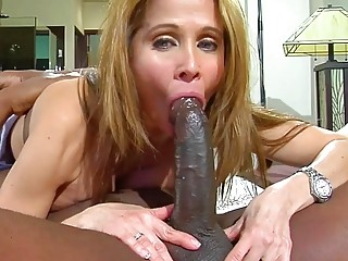 Voluptuous blonde enjoys a hardcore interracial after a hard day