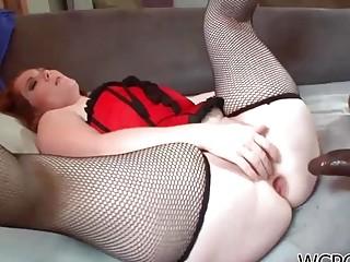 Big ass redhead woman enjoys interracial anal sex on sofa