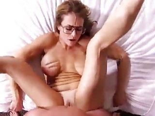 MILF with glasses sucks dick in POV before she's nailed