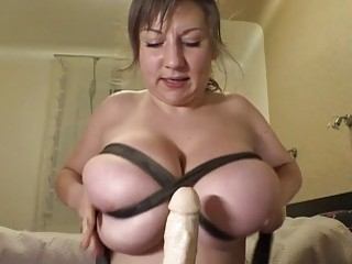 Busty chick using her big tits to tease you
