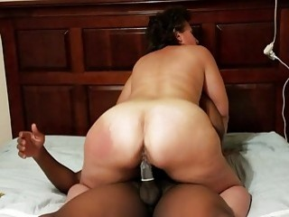 Brunette wife sucks and rides a big black cock