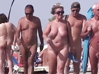 Horny sluts take care of dicks on a public beach