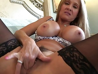 MILF teases while wearing stockings before giving a handjob