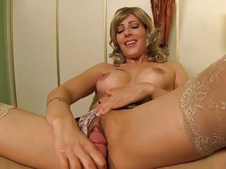 Mature teases before she gives an incredible handjob