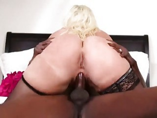 Blonde MILF in stockings challenges a big black cock
