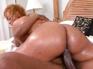 Sensational black babe oiled and rammed without mercy