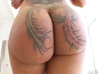 Beauty with a big tattooed ass gets pleasured hard