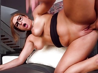 Redhead with glasses and big natural tits gets shagged hard