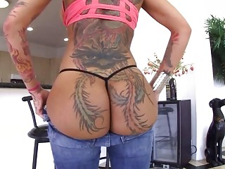 Beautiful tattooed chick in jeans teases with her big booty