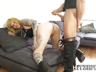 Sluty girl with a tattoo fucks hardcore on a couch