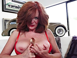 Mature babe Andi James loves toying her ass and pussy